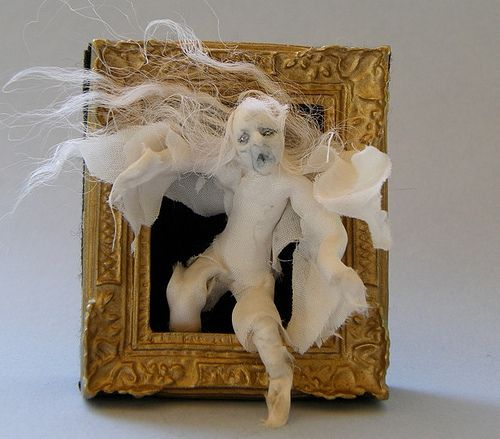 From the frame.  Spooky Halloween decor.  A ghost appears to float right from the picture frame.