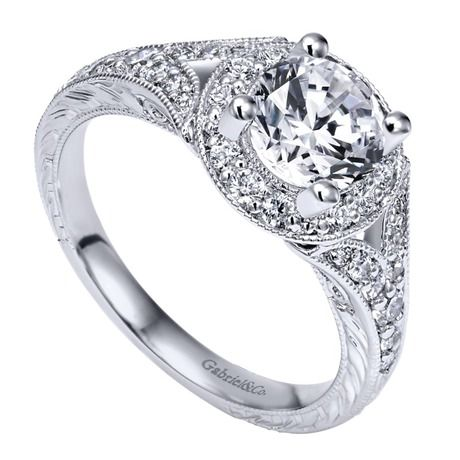 This white gold halo engagement ring looks just like an heirloom.