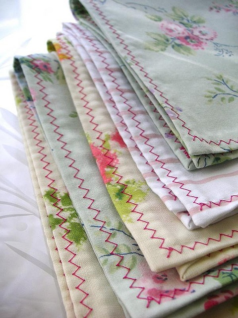 Take vintage hankies and sow them onto plain colored napkins. Now you have a delightful display of something old, something new and something unique for your table.
