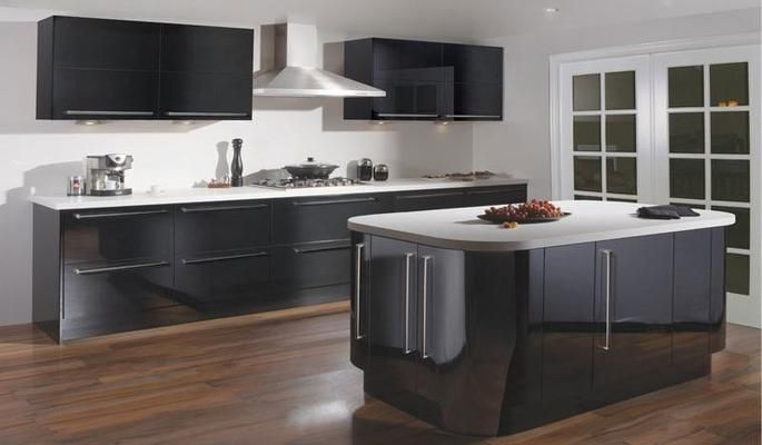 Our black gloss Paris kitchen features wipe-clean vinyl-wrapped doors and soft-close doors and drawers, so it looks and feels classy - whatever storm you cook up. #kitchen #blackgloss #fittedkitchen http://www.tescokitchens.com/kitchen-collections/paris-kitchen.html