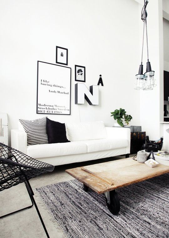 I Really like this blak and white room! I want to know where I can get me one of these coffee tables!
