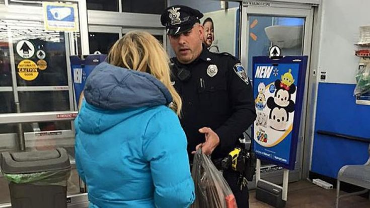 Officer Keith Perry helped prepare a homeless woman for Monday's storm, buying her groceries and helping her get to a hotel.