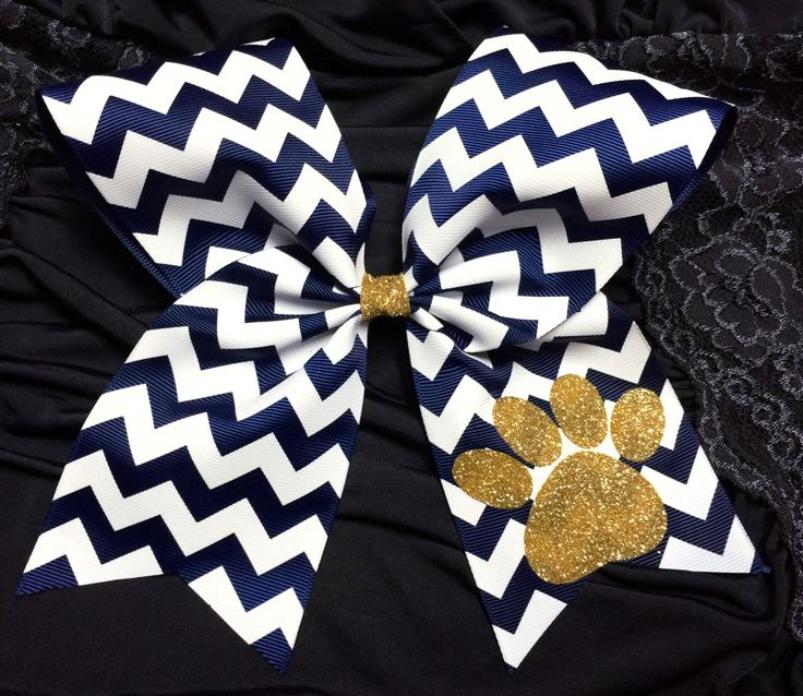 Navy Gold and White cheer bow with paw print/ Navy and White with Gold Glitter cheer bow/ paw print cheer bow/ glitter cheer bow by GirlyThingsandBlings on Etsy https://www.etsy.com/listing/236426093/navy-gold-and-white-cheer-bow-with-paw