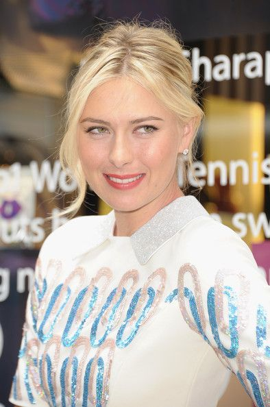 Maria Sharapova French Twist - Maria paired her preppy cocktail dress with a delightfully messy updo.