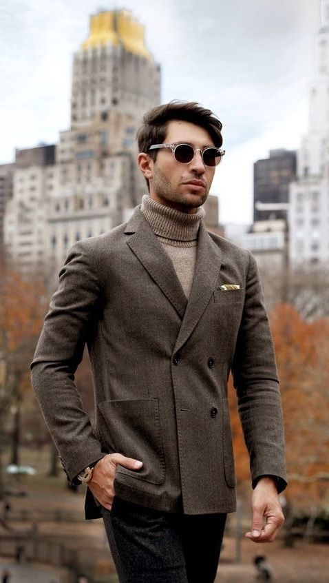 457599695255 Brown double breasted blazer light brown turtleneck sweater navy trousers  sunglasses patterned silk pocket square. model unknown.