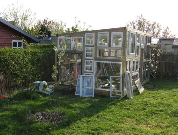 backyard-tiny-hobby-house-made-of-recycled-windows-001