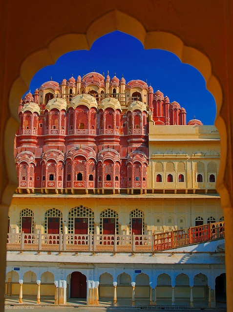"""Hawa Mahal or """"Palace of Winds"""" in Jaipur India.  Inside the main structure contains the 853 windows which the Queens (Maharanis) of Jaipur used to view the city and enjoy the royal procession."""