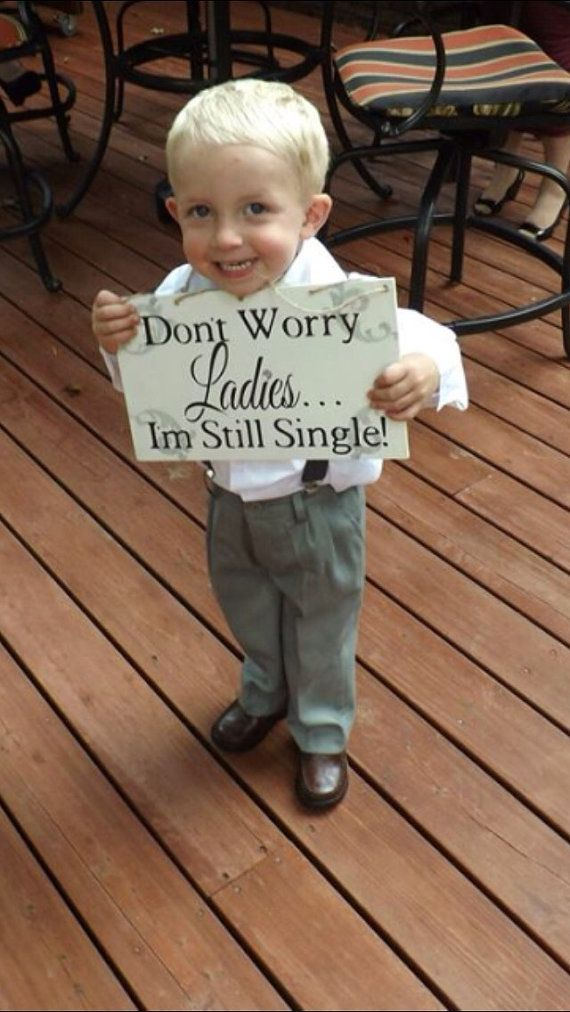 http://rubies.work/0082-ruby-rings/ Don't worry ladies I'm still single ring bearer sign by KerriArt