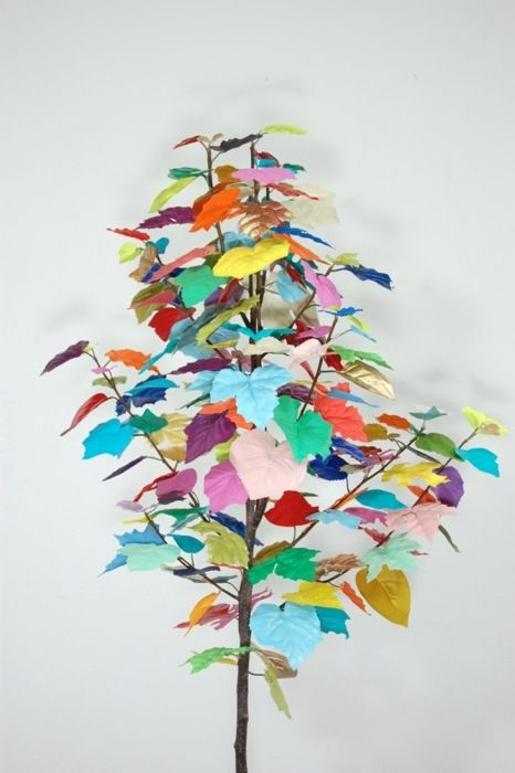 pick up a simple branch (with a lot of leaves) and paint each leaf a different color! this would be awesome in a vase!: