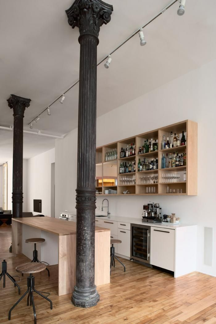 Open office loft, wood floors, white walls, cast iron columns, 13 ft high celings, maple kitchen island, open kitchen shelves, Magdalena Keck