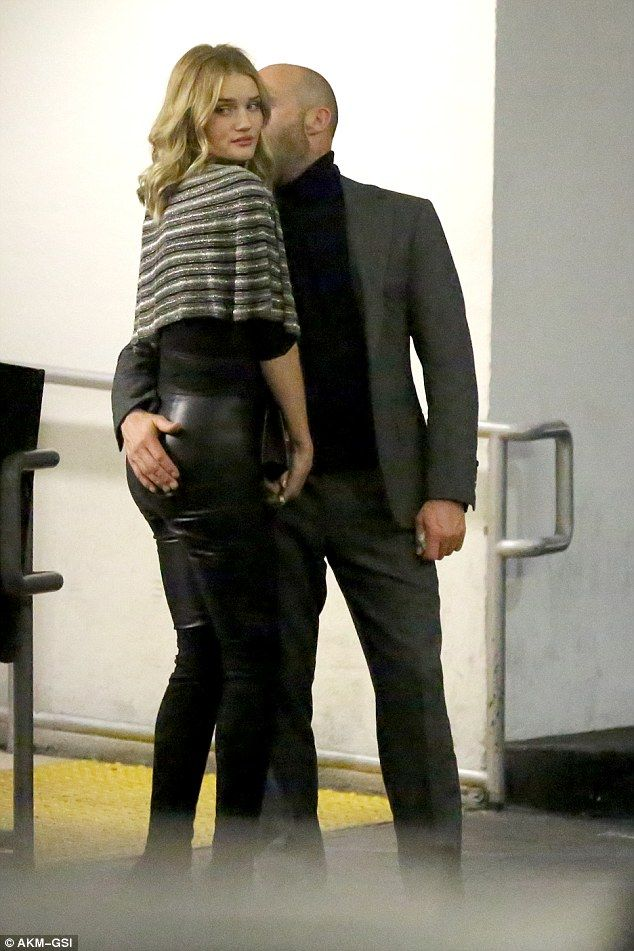 Cheeky! Jason Statham and Rosie Huntington-Whiteley looked completely smitten as they enjo...