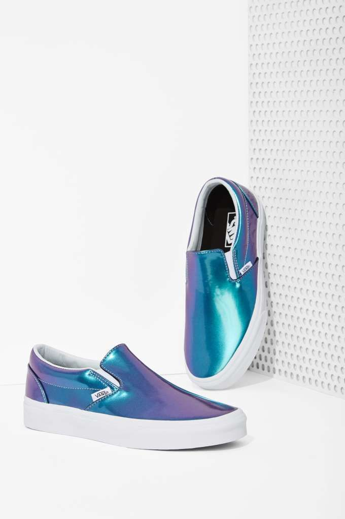 Get your shine on in these iridescent slip-on sneakers by Vans.