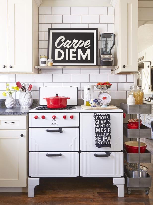 """""""The turnkey kitchen sold us on the house,"""" says Emily. With white cabinets, black soapstone countertops, and a space-smart layout, the only update it needed was a new backsplash. The foot-long subway tiles """"really highlight the gray grout,"""" she says. She found the 1930s match-light Magic Chef enamel stove at an antiques shop for $180 and had it restored to like-new condition."""