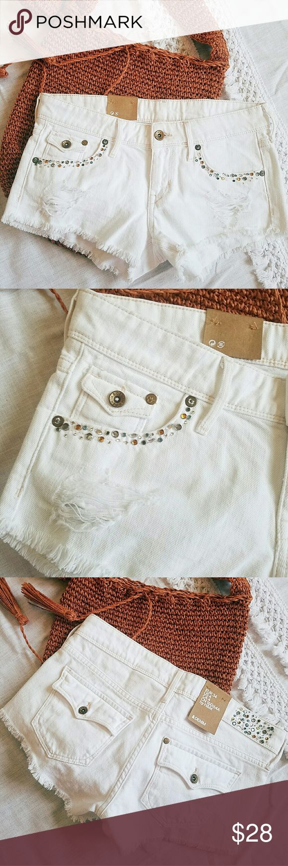 """H&M Bejeweled White Distressed Jean Shorts Cutoffs New with Tags H&M &Denim white bejewelled embellished cutoffs denim shorts. Flap back pockets. Zipper closure. Chic distressing and fraying along hem. Perfect for spring and festival season!  Size 34 (US 4)  Rise 7.25"""" / Inch Seam 2.25"""" / Waist 15""""   100% Cotton (a little stretch) H&M Shorts Jean Shorts"""