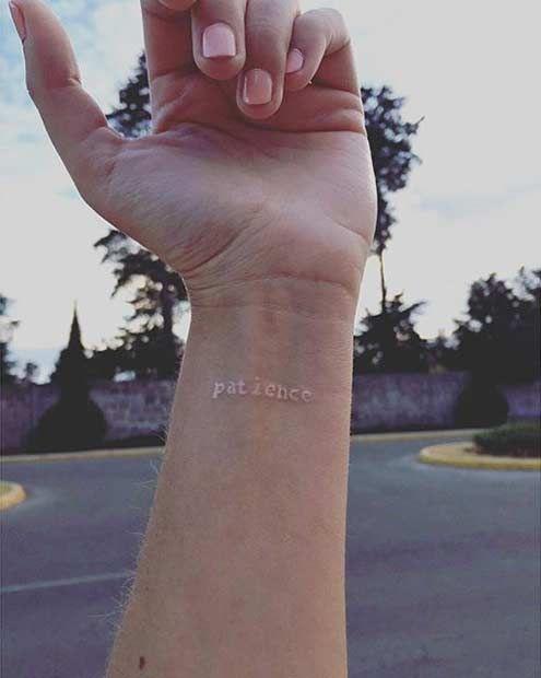 White Ink Wrist Tattoo - Patience.