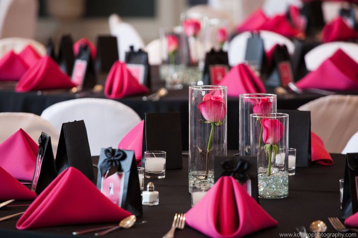 Hot pink gives a black and white color scheme a pop of color in napkins and hot pink roses. Wedding Planning by MuseEvents.com