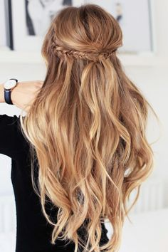 Beautiful blonde wavy hair! Half up half down with braids. Try a soft finish hairspray to keep curls in place