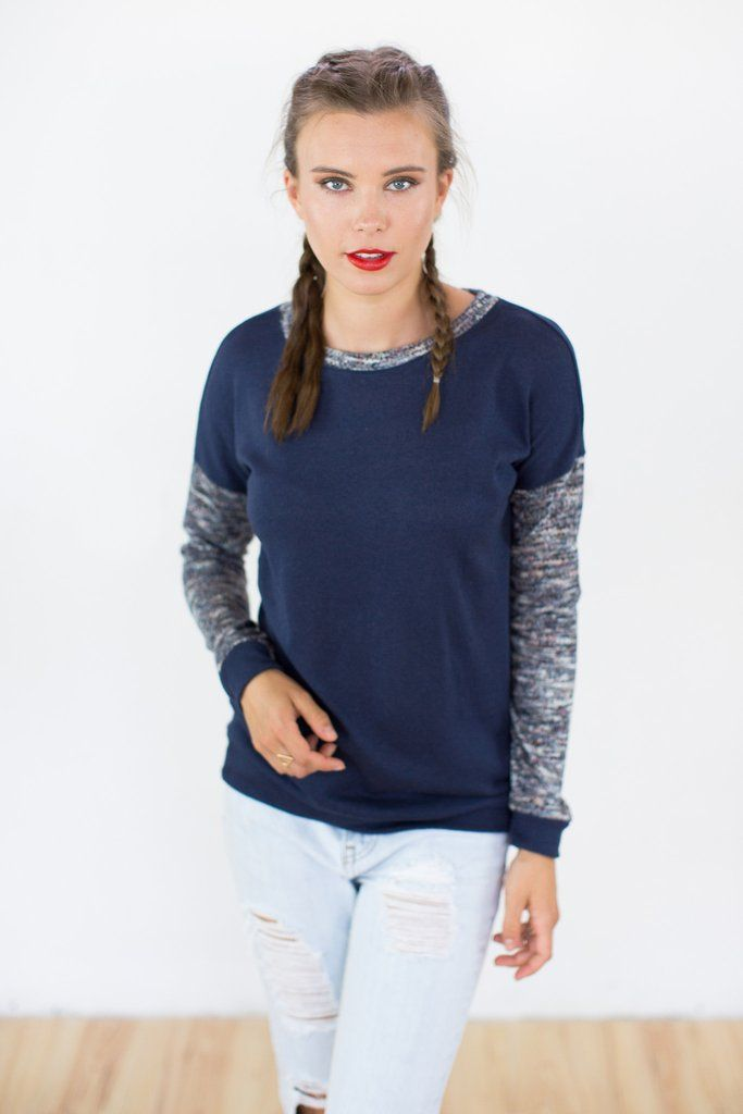 Sweater Tabinski Navy.Casual and cosy sweater crafted from a thin knit navy fabric. The sleeves and neckline are made of a mottled fabric in blue, orange and cream tones. Easy to combine with a pair of skinny jeans, it can be worn every hour of the day.