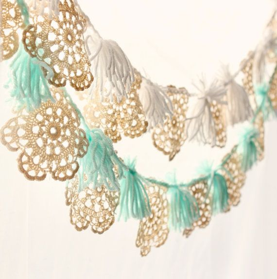 These super fun garlands are made with vintage circular ivory doilies that have been crocheted with some yarn, along with matching tassels!  ~~~