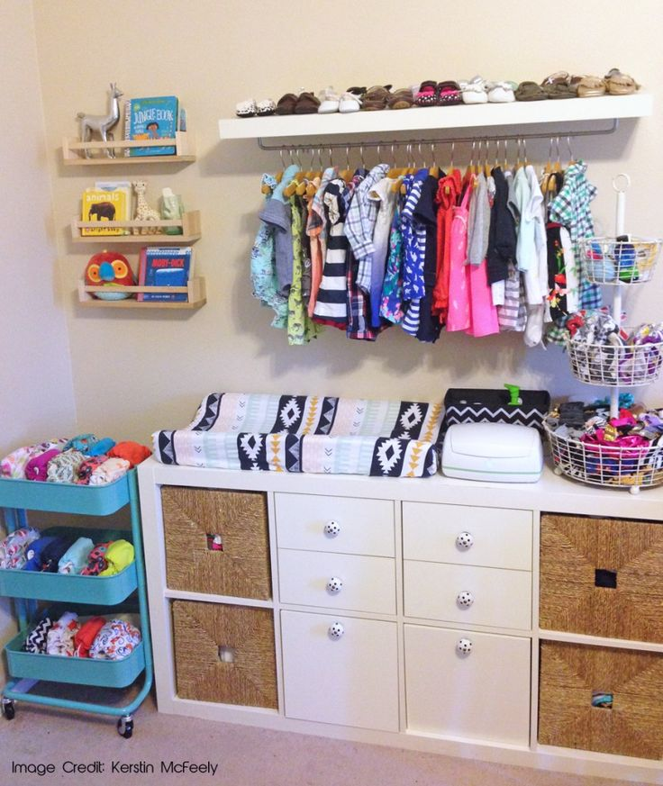 Baby clothes on display in tiny space + CD storage = <3