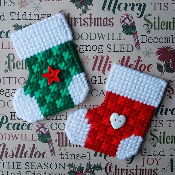 Christmas cheer, in magnet form! This listing is for 2 checked Christmas stocking magnets, sewn in cherry red, hot red, paddy green, emerald and white yarns. Each stocking is approximately 3 inches wide and 3 1/4 inches high. The stockings have a cute button (heart and star) sewn to the front for added detail. Thank you for checking out my Etsy shop