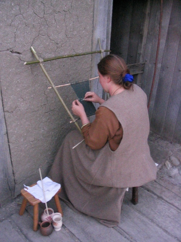 Reenactor at Archeon using a simple sprang loom of sticks lashed together