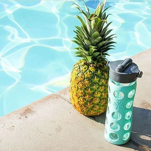 Pineapples by the pool. Summer may be over but we've still got this beautiful Lifefactory glass water bottles available in our online store. Link above lovers!