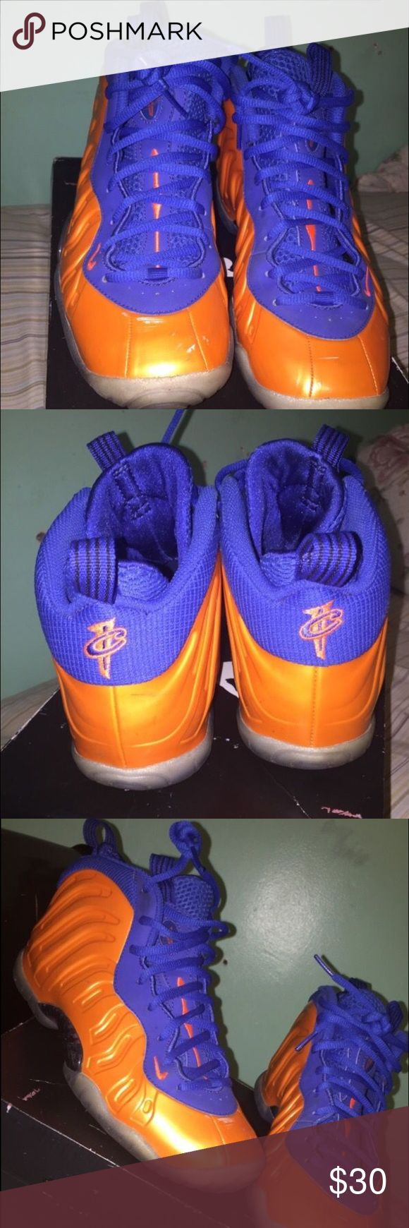New York Knicks Foamposites Orange & Blue foamposites, size 7y, there are a few scuffs (picture shown) and the bottoms aren't icy, but still like new and great shoes. Comes with OG box. Nike Shoes Sneakers
