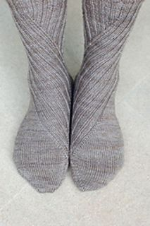 The Slide socks are a traveling rib sock that angles the rib down the leg and the foot, just like a playground slide. These were inspired by the color of the yarn. I love the simplicity of these, and of course the pair is mirrored.