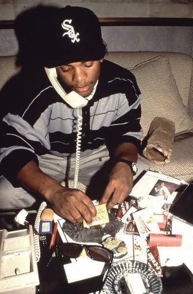 Eazy E.. When phones had cords lol. Is he rolling on Ice Cube or a pic of himself?