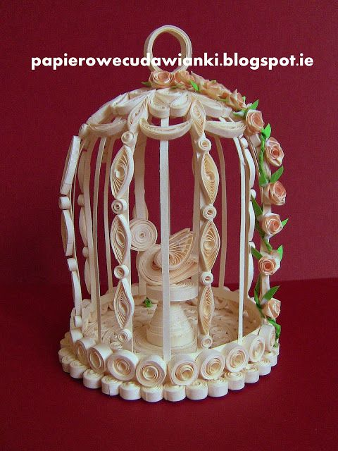Quilling-cage with a bird