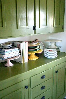 Kitchen decorating tip: Stack books on colorful cake stands for an elegant look.
