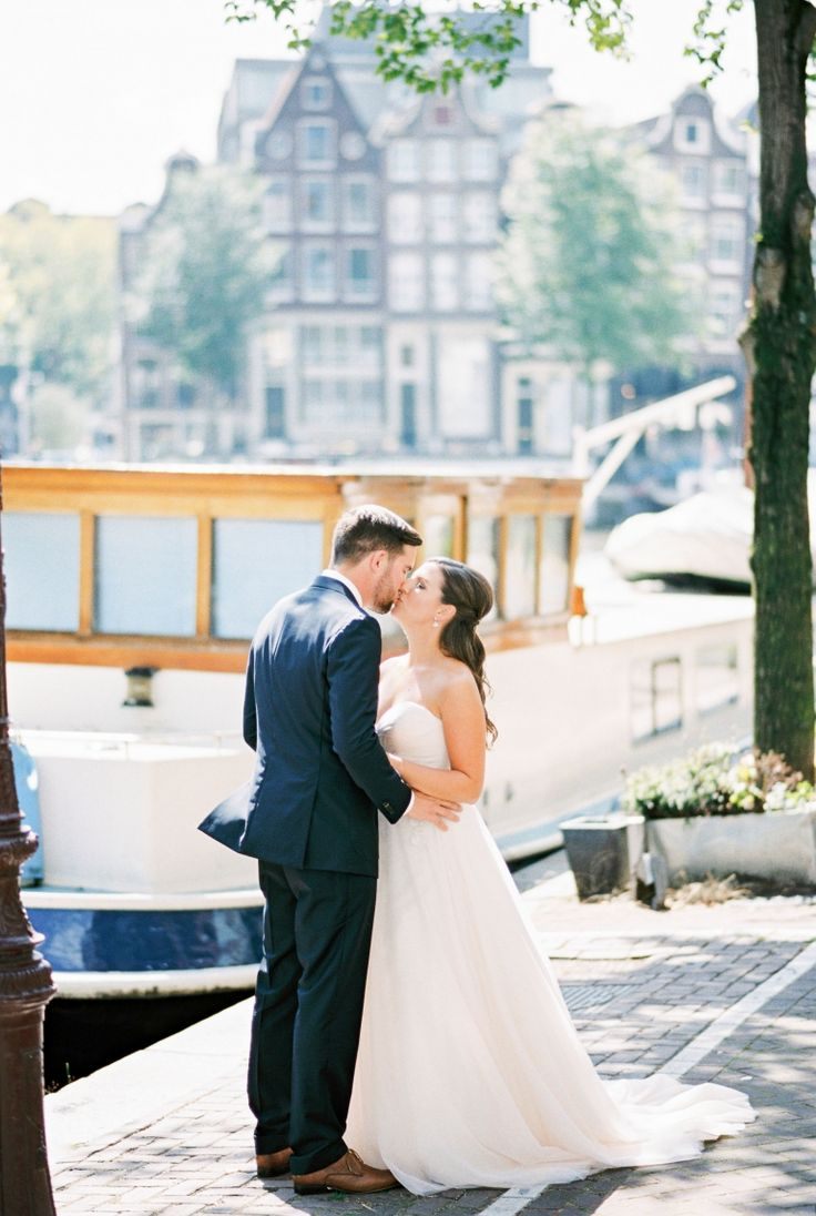 Romantic photos on the canals.. Wedding Elopement Photographer Amsterdam | Engagement Session | Film Photographer