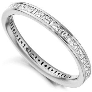 Set with one carat of square princess cut diamonds, alongside baguette cut diamonds, this full eternity ring is precision set along a court shaped band.