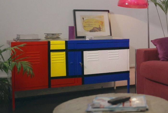 Mondrian inspired cabinet painted with Pintyplus Evolution aerosol paint in red, blue, yellow and black for a modern feel.