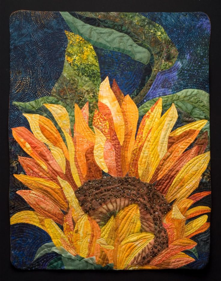 "Sunflower by Karen Burton | art quilt. ""The blue background is pieced and everything else is appliqued onto it."""