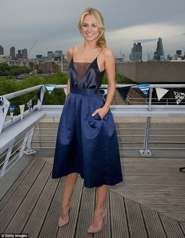 Stylish: Kimberley Garner looked stunning in a midnight blue Closet evening dress with a c...