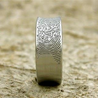 This is a man's wedding ring with wife's fingerprint... such a romantic idea. ♥ http://www.etsy.com/listing/90829542/fingerprint-wedding-band-in-8mm-sterling?utm_source=googleutm_medium=product_listing_promotedutm_campaign=jewelry_midgclid=CNfhg5KvvbsCFcpDMgodECQAXA