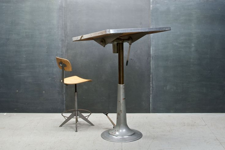 Sweden, c.1950s. Industrial Architects Vintage Hydraulic Drafting Table by Nike of Eskilstuna, Sweden. Cast Iron and Polished Steel Base, Micarta and Wood Drawing Surface, 2¼ Inch Top,  Stainless Steel Edge Banding. Fully Functional, Smooth and Silent Hydraulic Foot Pedal Elevation System.    W: 42 x D: 30 x H: 30-56¼ in.