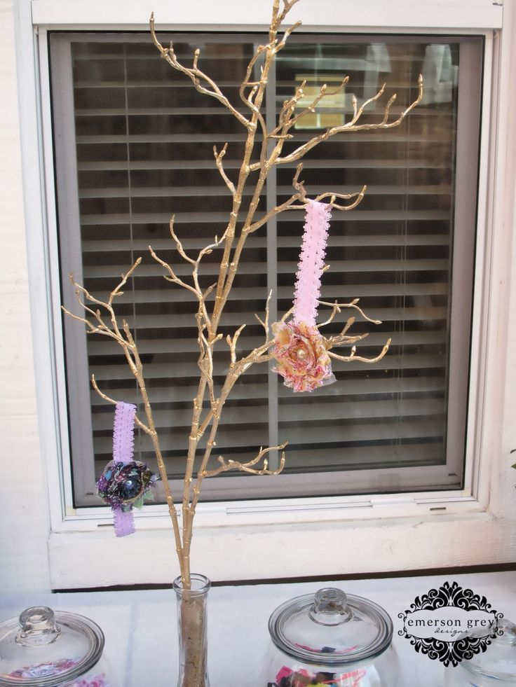 I love this shabby chic baby shower idea. Have your guest hang their flower headbands they created on a branch. Find headbands, flowers and supplies at www.boutiquesupplco.com