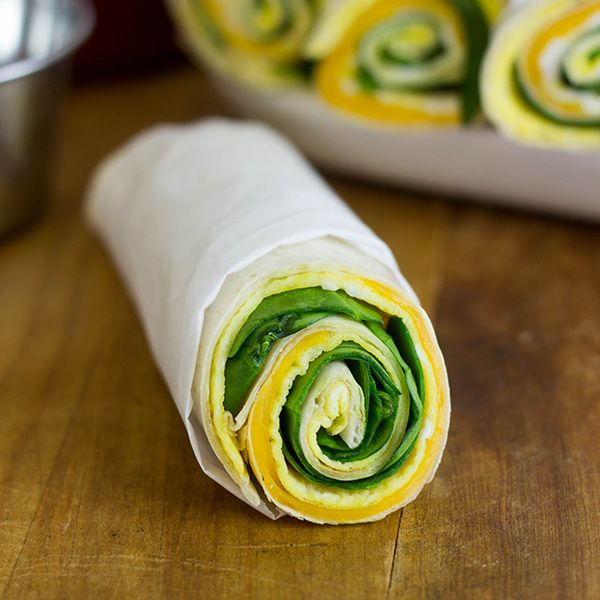 Easy Breakfast Roll-Ups  --  egg is cooked flat like an omelet so it lines up with the tortilla. Also used sliced cheese. The goal is to keep the toppings relatively flat so it rolls up smoothly. (Picture shows baby spinach included. Could use any ingredient you would put in an omelet.)