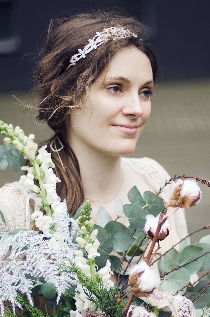 Winter and Christmas styled photo shoot. Rustic table setting and a story about a princess from children's book. Organic and natural, bouquets in boho style and animal details on cutlery. Cotton branch. Bride with flowers.