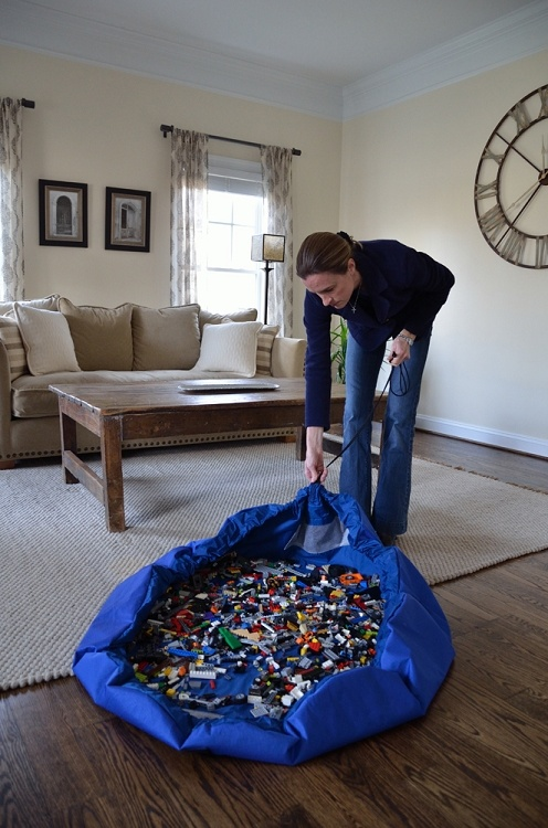 OMG, where was this when we had Legos all over the house?  Play mat that draws up into a bag.  SO SMART!