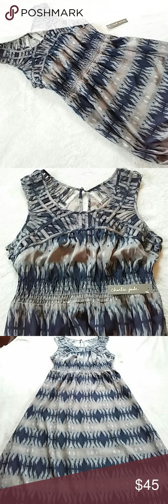 """🆕 Listing! NWT Charlie Jade Maxi Dress Gorgeous Charlie Jade maxi dress in shades of gray, cream and dark blue with an ikat print. Unique caged design on neckline, shoulders and around the back. Smocked waist. About 15.5"""" pit to pit. 13"""" waist not stretched. Stretches out to about 16"""". About 58"""" long. Extra button included. 100% polyester. Charlie Jade Dresses Maxi"""