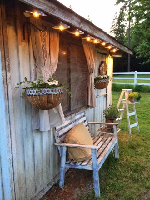 love the lighting & the siding.  So cute to have curtains on the outside.