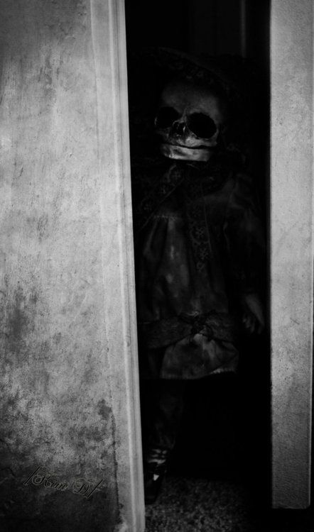 creepy shot of little girl with mask on..Vintage Photo