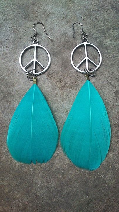 Peace earrings with turquoise feathers.  https://www.facebook.com/featherprojectlk/
