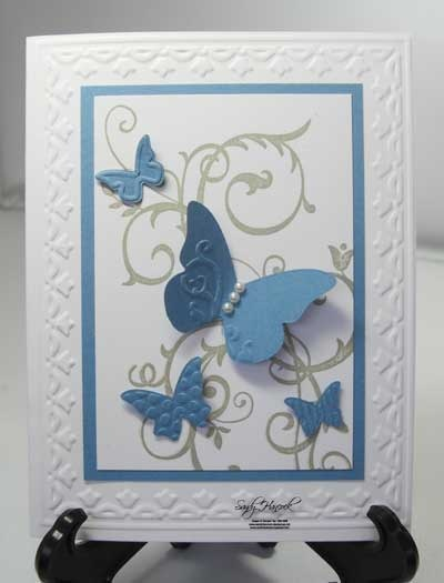 Hmm, I have that frame, that butterfly embosslet but I don't have that swirly stamp. Must buy!!
