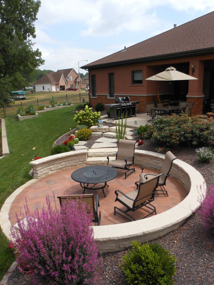 backyard landscaping, I love the designated seating area with the chairs and fire pit that is away from the grass where the kids play.