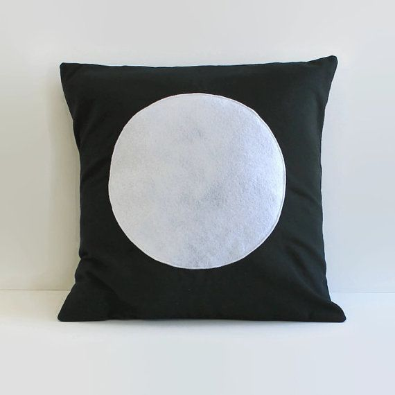 Product Description: Black home dec weight cotton pillow with white felt circle applique.  Pillow cover fits a eighteen inch pillow form (18X18) with